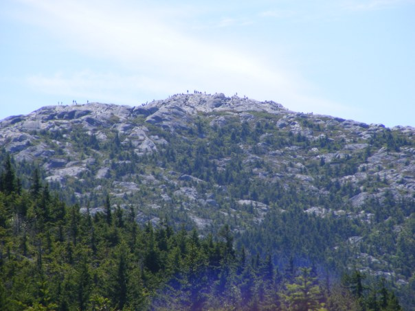 Mount Monadnock's summit, lined with hikers