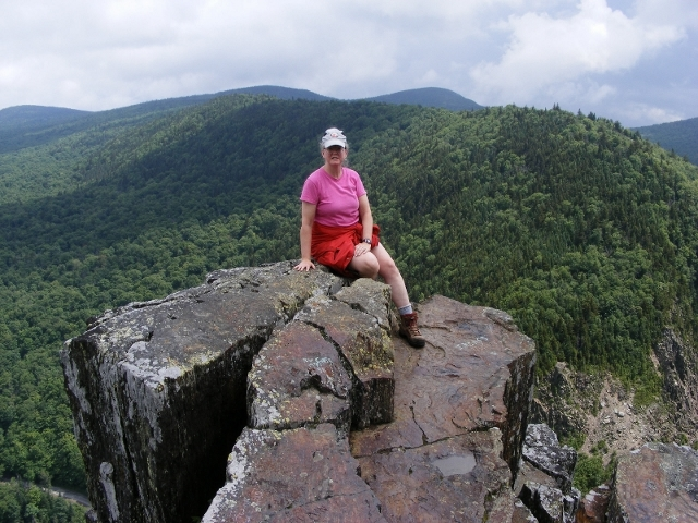 Blog author Ellen Kolb, perched on Table Rock in Dixville Notch in northern NH.