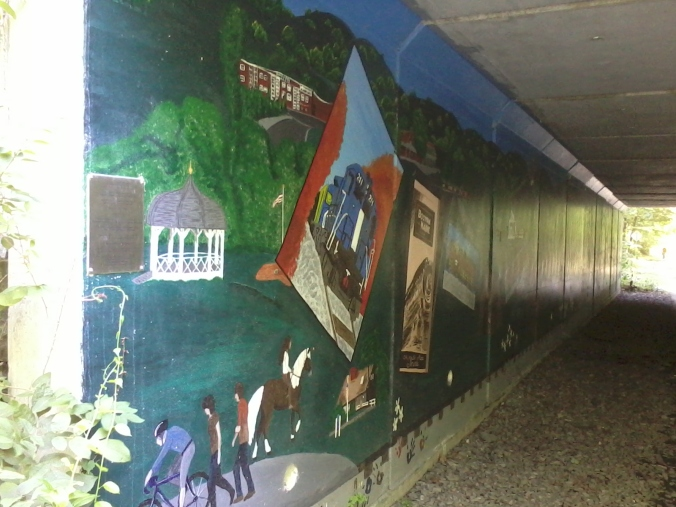 Local students painted the walls of the trail's underpass at Rt. 225 with scenes of area history.