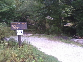 The white addition to the trail sign is an invitation to come to the Pack Monadnock summit for September's raptor watch.