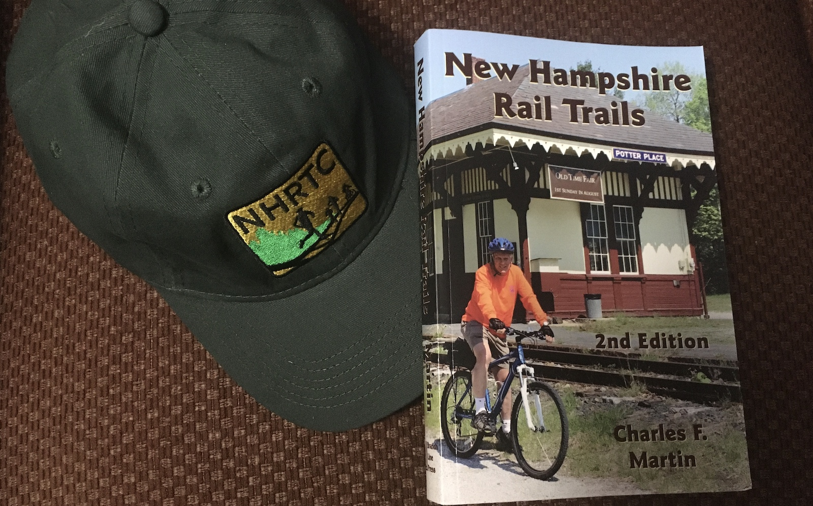 New Hampshire Rail Trails Coalition hat and book